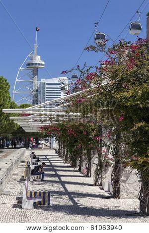 Lisbon, Portugal - August 02, 2013: Passeio Ribeirinho (Waterfront Sidewalk), Vasco da Gama Tower, Myriad Hotel and aerial tramway. Park of Nations.