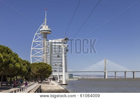 Lisbon, Portugal - August 02, 2013: Vasco da Gama Tower, the Myriad Hotel, the aerial tramway and the Vasco da Gama Bridge in the Park of Nations.