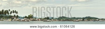 Village of fishermen on tropical coast.Panorama.