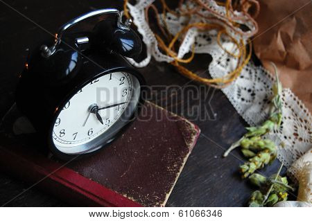 Retro Alarm Clock on an old book