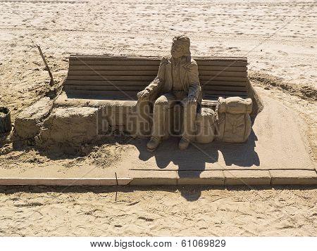 Traveler Sand Sculpture On The Beach