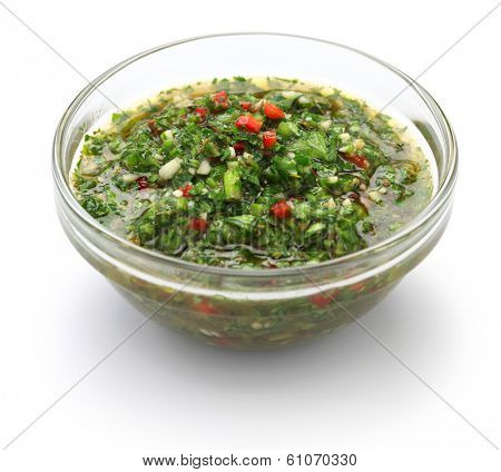 chimichurri sauce is a traditional Argentine condiment, made from finely chopped parsley, minced garlic, olive oil, oregano, and wine vinegar.