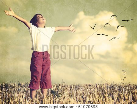 Colorized kid breathing fresh air with birds flock flying in background