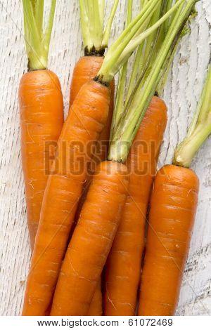 Organic Carrots On White Wood
