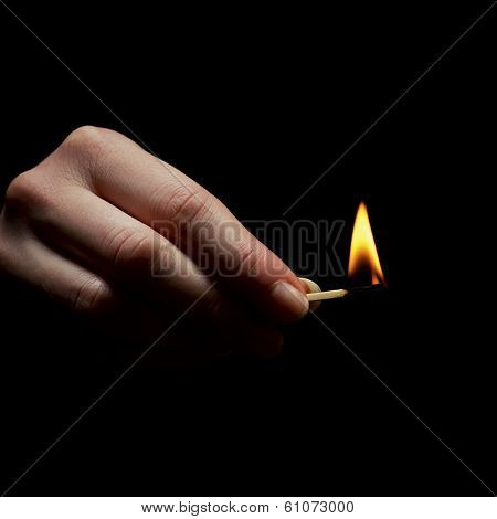 Holding a Lighted Match