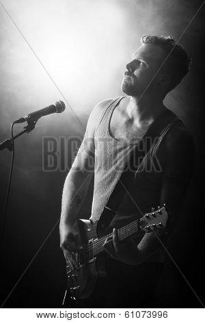 Rocker in Concert Play Guitar
