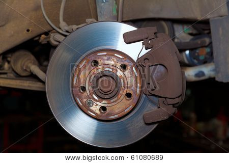 Car wheel brake rusty disc with pads rotor disc and caliper assembly