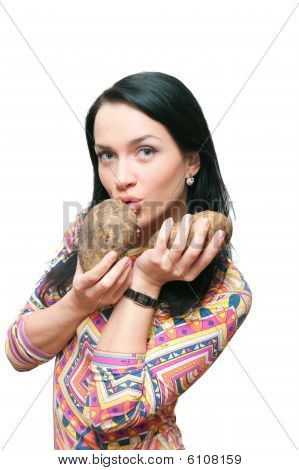 The Girl With A Crude Potato In Hands