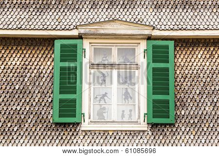 open window of a historic house with wooden facade