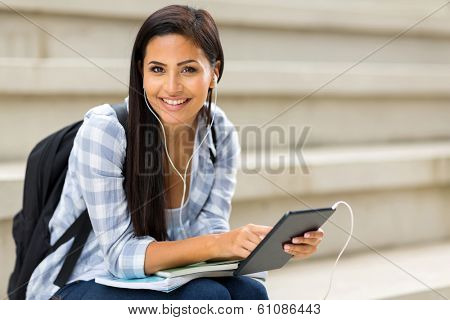 pretty college student holding tablet computer