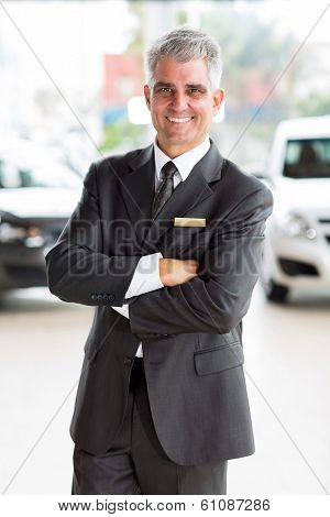 happy middle aged man working at car dealership
