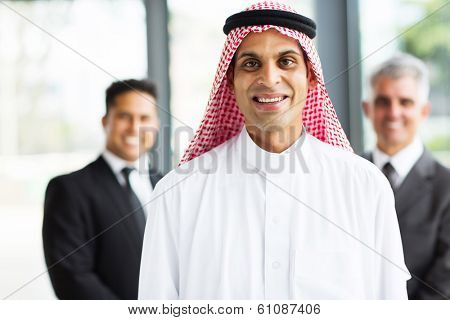 happy muslim businessman with team on background