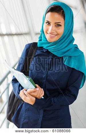 beautiful middle eastern college girl holding books