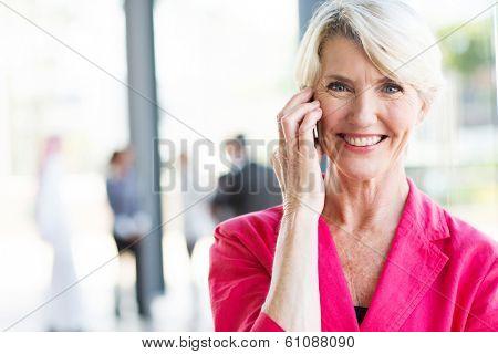 portrait of senior businesswoman talking on cell phone