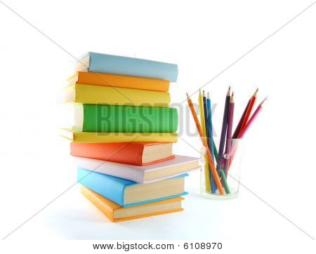 A Stack Of Color Books And Pencils