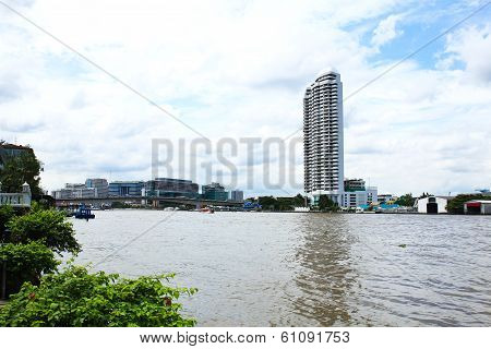 Buildings Along The River. The View From Santi Chai Prakan Park. Attractions In Bangkok, Thailand.