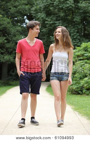 Attractive Young Teenage Couple Out Walking