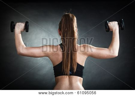 Fitness Girl Training Shoulder Muscles Lifting Dumbbells Back View