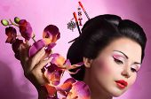 picture of geisha  - Portrait of a Japanese geisha woman on the pink background - JPG