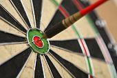 image of bullseye  - Dartboard with dart on bullseye - JPG