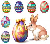 Illustration of the colorful Easter eggs and a bunny on a white background