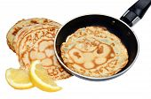 stock photo of tuesday  - Freshly made pancakes with lemon and frying pan - JPG