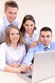 Successful young businesspeople working at office