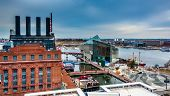 stock photo of pov  - View of the Power Plant and the Inner Harbor from a parking garage in Baltimore Maryland - JPG