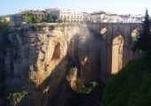 stock photo of parador  - Ancient Spanish town Ronda with beautiful bridge between cliffs - JPG