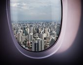 beautiful city view of Bangkok with blue sky from plane window