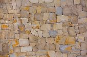 Masonry wall texture of handmade stones traditional style in Spain