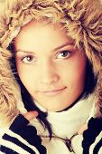 Teen woman in winter jacket with fur around her face