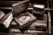 picture of longitude  - Wooden compass on vintage books - JPG