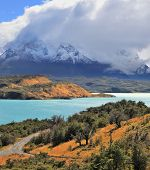 Cold summer in Chile. The National Park Torres del Paine - the emerald waters of the Rio Serrano and