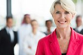 pic of close-up middle-aged woman  - happy senior business woman close up - JPG