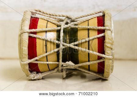 Small two-headed drum called as Damru used in Hinduism and Tibetan buddism