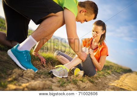 Female runner with injured knee