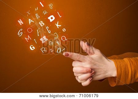 Glowing letters coming out of gun shaped hands