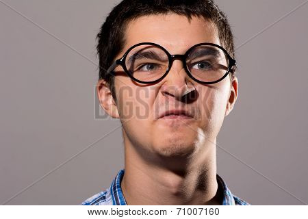 Portrait Of A Man In Glasses With A Silly Expression On His Face.