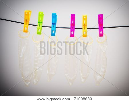 Six Condoms Drying On The Rope. Funny Conceptual Photo.