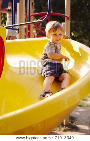 Little Boy Playing In A Kids Playground