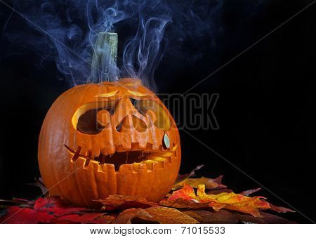 Smoking halloween pumpkin head with copy space