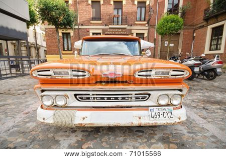 Orange 1960 Chevy Apache truck car showed in the exterior of a restaurant in Leon Spain on August 22