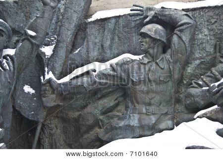 bas-relief sculpture honoring World War II soldiers