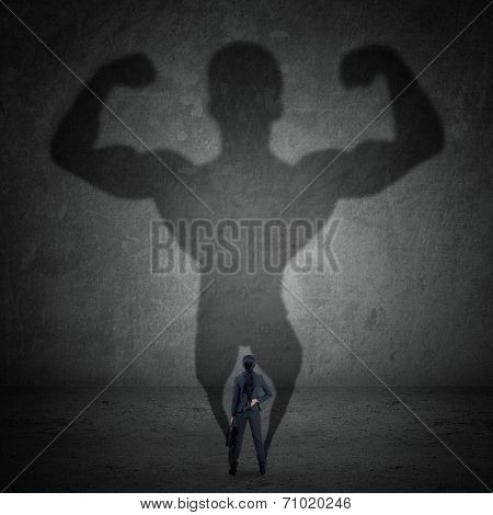 Businesswoman And Strong Shadow