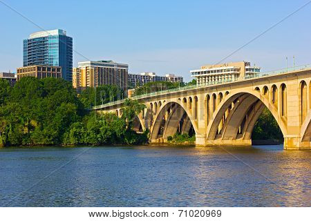 Key Bridge in Washington DC with office building on background.