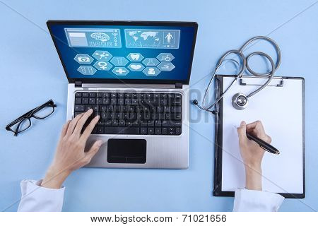 Doctor Writing Prescription On Clipboard