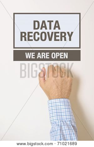Businessman Knocking On Data Recovery Office Door