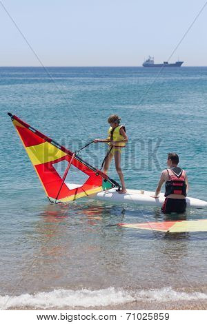 Little Girl Learning Windsurfing