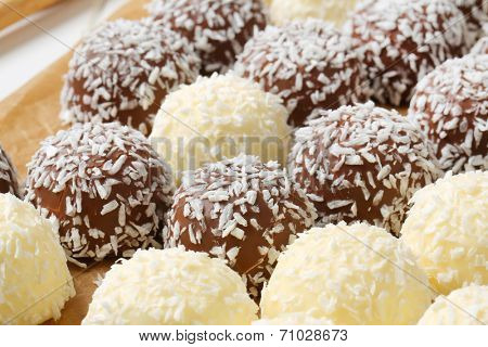 Chocolate snowball truffles rolled in coconut